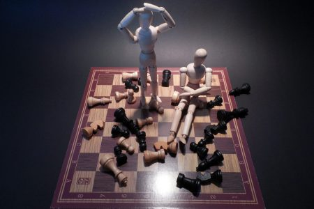 toy soldiers on top of a chessboard
